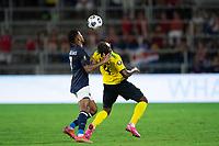 ORLANDO, FL - JULY 20: Johan Venegas #7 of Costa Rica and Amari'i Bell #4 of Jamaica battle for the ball during a game between Costa Rica and Jamaica at Exploria Stadium on July 20, 2021 in Orlando, Florida.