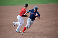 Lowell Spinners Korby Batesole (12) running the bases as third baseman Denis Karas (9) gets in position during a game against the Batavia Muckdogs on July 15, 2018 at Dwyer Stadium in Batavia, New York.  Lowell defeated Batavia 6-2.  (Mike Janes/Four Seam Images)