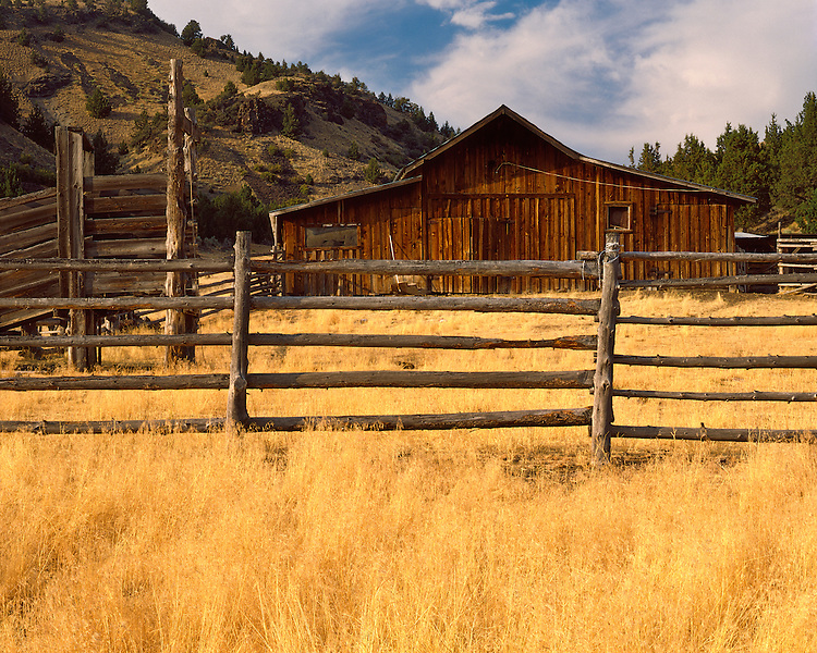 Old barn and fence on a ranch near Mitchell; Wheeler County, OR