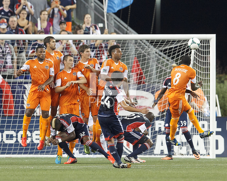 Houston Dynamo wall, Jermaine Taylor, Eric Brunner, Cam Weaver, Bobby Boswell, and Giles Barnes react to New England Revolution midfielder Lee Nguyen (24) direct kick which sails over the cross bar. The New England Revolution players dropped as Lee Nguyen kicked. In a Major League Soccer (MLS) match, Houston Dynamo (orange) defeated the New England Revolution (blue), 2-1, at Gillette Stadium on July 13, 2013.