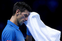Novak Djokovic of Serbia towels off at the ATP World Tour Finals, The O2, London, 2015