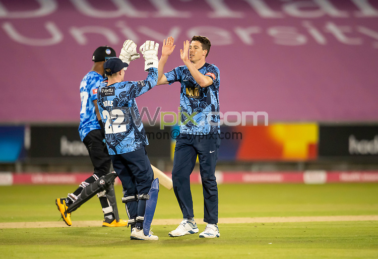 Picture by Allan McKenzie/SWpix.com - 24/08/2021 - Cricket - Vitality Blast Quarter Final - Yorkshire Vikings v Sussex Sharks - Emirates Durham ICG, Chester-le-Street, England - Viking's Matthew Fisher is congratulated on dismissing the Sharks's Delray Rawlins.