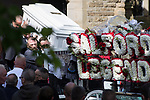 """© Joel Goodman - 07973 332324 . 28/08/2015 . Salford , UK . Paul Massey's coffin is carried from the church after the service . The funeral of Paul Massey at St Paul's CE Church in Salford . Massey , known as Salford's """" Mr Big """" , was shot dead at his home in Salford last month . Photo credit : Joel Goodman"""