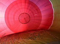 Inside the balloon's nylon envelope during inflation, British School of ballooning, Ebernoe, West Sussex.