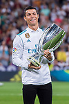 Cristiano Ronaldo of Real Madrid holds one of their trophies prior to the La Liga 2017-18 match between Real Madrid and Valencia CF at the Estadio Santiago Bernabeu on 27 August 2017 in Madrid, Spain. Photo by Diego Gonzalez / Power Sport Images