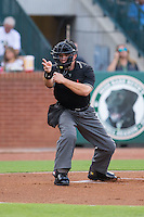 Home plate umpire Chris Scott makes a strike call during the South Atlantic League game between the Greenville Drive and the Greensboro Grasshoppers at NewBridge Bank Park on August 17, 2015 in Greensboro, North Carolina.  The Drive defeated the Grasshoppers 5-4 in 13 innings.  (Brian Westerholt/Four Seam Images)