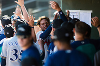 Peoria Javelinas center fielder Cristian Pache (27), of the Atlanta Braves organization, celebrates with his teammates in the dugout after a two-run home run by Hudson Potts (not pictured) during an Arizona Fall League game against the Surprise Saguaros at Surprise Stadium on October 17, 2018 in Surprise, Arizona. (Zachary Lucy/Four Seam Images)