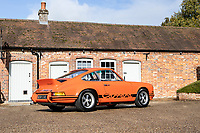 BNPS.co.uk (01202 558833)<br /> Pic: Bonhams/BNPS<br /> <br /> Pictured: 1973 Porsche 911 Carrera RS 2.7-Litre 'Lightweight' Coupé<br /> <br /> Cosmic Cars...<br /> <br /> Three barely used supercars belonging to Jamiroquai singer Jay Kay have emerged for sale for nearly £2.5m.<br /> <br /> The 1973 Porsche 911, 2016 Ferrari F12 and 2004 Porsche Carrera GT are among around 100 vehicles owned by the acid jazz star.<br /> <br /> As such they have been scarcely used during their time with the musician and he has now decided to trim his collection.
