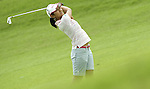 SINGAPORE - MARCH 07:  Ai Miyazato of Japan hits her second shot on the par four 17th hole during the third round of HSBC Women's Champions at the Tanah Merah Country Club on March 7, 2009 in Singapore.  Photo by Victor Fraile / The Power of Sport Images