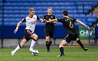 Bolton Wanderers' Eoin Doyle competing with Oldham Athletic's Ben Garrity (right) <br /> <br /> Photographer Andrew Kearns/CameraSport<br /> <br /> The EFL Sky Bet League Two - Bolton Wanderers v Oldham Athletic - Saturday 17th October 2020 - University of Bolton Stadium - Bolton<br /> <br /> World Copyright © 2020 CameraSport. All rights reserved. 43 Linden Ave. Countesthorpe. Leicester. England. LE8 5PG - Tel: +44 (0) 116 277 4147 - admin@camerasport.com - www.camerasport.com