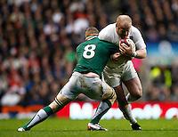 Photo: Richard Lane/Richard Lane Photography. England v Ireland. 17/03/2012. England's Dan Cole is tackled by Ireland's Jamie Heaslip.