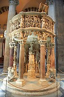 Medieval relief sculpturs on the pulpit  in the interior of the Duomo, Pisa, Italy