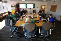 The UAA Incident Management Team (IMT) meets in the Admin Building with many members participating via teleconference as they coordinate campus response to the spread of COVID-19.