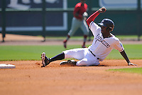 Northwest Arkansas Naturals Orlando Calixte (7) slides into second base during the game against the Springfield Cardinals at Arvest Ballpark on May 4, 2016 in Springdale, Arkansas.  Springfield won 10-6.  (Dennis Hubbard/Four Seam Images)