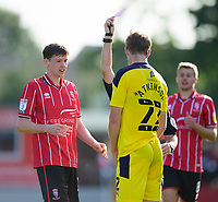 Oxford United's Rob Atkinson is shown a red card by referee Andy Davies, watched by Lincoln City's Conor McGrandles, left<br /> <br /> Photographer Andrew Vaughan/CameraSport<br /> <br /> The EFL Sky Bet League One - Saturday 12th September  2020 - Lincoln City v Oxford United - LNER Stadium - Lincoln<br /> <br /> World Copyright © 2020 CameraSport. All rights reserved. 43 Linden Ave. Countesthorpe. Leicester. England. LE8 5PG - Tel: +44 (0) 116 277 4147 - admin@camerasport.com - www.camerasport.com - Lincoln City v Oxford United