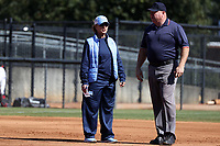 GREENSBORO, NC - FEBRUARY 22: Head coach Donna J. Papa of the University of North Carolina talks to an umpire during a game between Fairfield and North Carolina at UNCG Softball Stadium on February 22, 2020 in Greensboro, North Carolina.