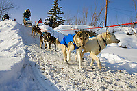 Louis Nelsons team mushes out of McGrath Chkpt onto Kuskokwim River 2006 Iditarod Interior AK Winter