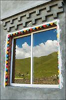 Reflection in a Tibetan window.