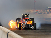 Mar. 7, 2009; Bakersfield, CA, USA; Nostalgia funny car driver Tom Padilla blows the body off his car after suffering an explosion during qualifying for the 51th annual March Meet at the Auto Club Famoso Raceway. Mandatory Credit: Mark J. Rebilas-