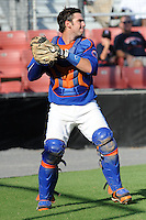 Kingsport Mets catcher Tomas Nido #7 fields a pop up during a game against the Bristol White Sox at Hunter Wright Stadium on July 28, 2012 in Kingsport, Tennessee. The Mets defeated the White Sox 9-5. (Tony Farlow/Four Seam Images).