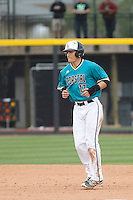 University of Coastal Carolina Chanticleers first baseman Billy Cooke (17) running the bases during a game against the University of Virginia Cavaliers at Springs Brooks Stadium on February 21, 2016 in Conway, South Carolina. Coastal Carolina defeated Virginia 5-4. (Robert Gurganus/Four Seam Images)