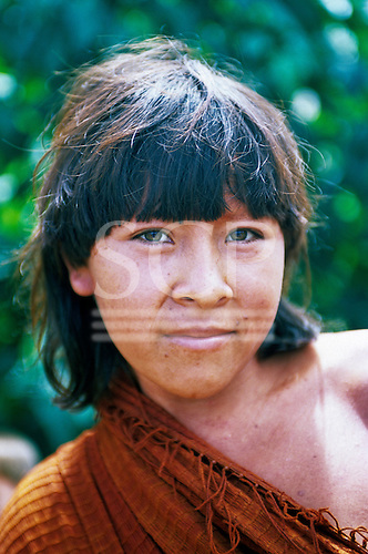 Ipixuna village, Amazon, Brazil. Young Arawete woman with green eyes and traditional cotton cloth.