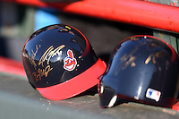 Cleveland Indians mini helmets signed by members of the Akron RubberDucks sit on the seating wall before a game against the Erie SeaWolves on May 17, 2014 at Jerry Uht Park in Erie, Pennsylvania.  Erie defeated Akron 2-1.  (Mike Janes/Four Seam Images)