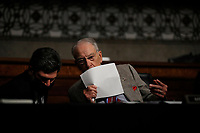 United States Senator Chuck Grassley (Republican of Iowa) speaks to an aide during a US Senate Judiciary Committee business meeting on Capitol Hill in Washington, Thursday, June 11, 2020, to consider authorization for subpoenas relating to the Crossfire Hurricane investigation, S.685, to amend the Inspector General Act of 1978 relative to the powers of the Department of Justice Inspector General, and the nomination of Cory T. Wilson, of Mississippi, to be United States Circuit Judge for the Fifth Circuit.<br /> Credit: Carolyn Kaster / Pool via CNP/AdMedia