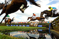 Low angle view of horses as they make a jump during the Queen's Cup Steeplechase in Mineral Springs, NC.