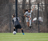 LOUISVILLE, KY - MARCH 13: Yuki Nagasato #17 of Racing Louisville FC gains possession from Gabrielle Robinson #8 of West Virginia University during a game between West Virginia University and Racing Louisville FC at Thurman Hutchins Park on March 13, 2021 in Louisville, Kentucky.