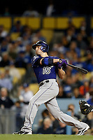 Jordan Pacheco #15 of the Colorado Rockies bats against the Los Angeles Dodgers at Dodger Stadium on April 30, 2013 in Los Angeles, California. (Larry Goren/Four Seam Images)
