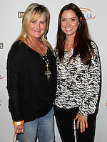 HOLLYWOOD, LOS ANGELES, CA, USA - SEPTEMBER 18: Kelly Stone, Nancy Melnick arrive at the 'Get Lucky For Lupus' 6th Annual Poker Tournament held at Avalon on September 18, 2014 in Hollywood, Los Angeles, California, United States. (Photo by Celebrity Monitor)