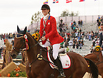 03 October 2010.  Selena O'Hanlon and Colombo during their victory lap after Canada win's the Silver Medal for Eventing.