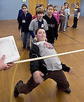 SEYMOUR, CT. 03 January 2008-010308SV05--Chatfield Elementary School student Kameron Matthews 10, of Seymour does the limbo with classmates and other 4th grade students from Washington Elementary School from West Haven at their school in Seymour Thursday. The two schools were having an exchange day where they spend the day together at the school.<br /> Steven Valenti Republican-American