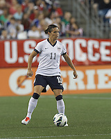 USWNT substitute defender Ali Krieger (11) controls the ball. In an international friendly, the U.S. Women's National Team (USWNT) (white/blue) defeated Korea Republic (South Korea) (red/blue), 4-1, at Gillette Stadium on June 15, 2013.
