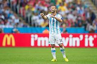 Javier Mascherano of Argentina shouts instructions