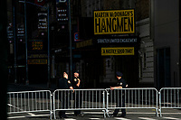NEW YORK, NEW YORK - JUNE 18: NYPD officers stand guard near Hells Kitchen area as city prepares for reopening on June 18, 2020 in New York City. New York City is preparing to enter phase 2 of reopening where restaurants and bars can offer outdoor dining this coming Monday. (Photo by Eduardo MunozAlvarez/VIEWpress)