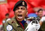 "A Venezuelan shouts while marching during a military parade in Valencia, Venezuela, on Saturday, June 24, 2006. The military parade was to celebrate Army Day and took place in ""Campo de Carabobo"", the field where the last big battle for the Venezuelan independence was won. (ALTERPHOTOS/Alvaro Hernandez)."