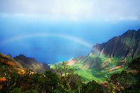 Rainbow as seen from Kalalau Lookout. Waimea Canyon. Kauai, Hawaii