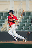 Alex Call (2) of the Kannapolis Intimidators follows through on his swing against the Greensboro Grasshoppers at Intimidators Stadium on July 17, 2016 in Greensboro, North Carolina.  The Grasshoppers defeated the Intimidators 5-4 in game two of a double-header.  (Brian Westerholt/Four Seam Images)