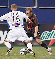 Clint Mathis of the MetroStars is marked by Craig Waibel of the Earthquakes. The San Jose Earthquakes and the the NY/NJ MetroStars played to a 4-4 tie on 7/02/03 at Giant's Stadium, NJ..