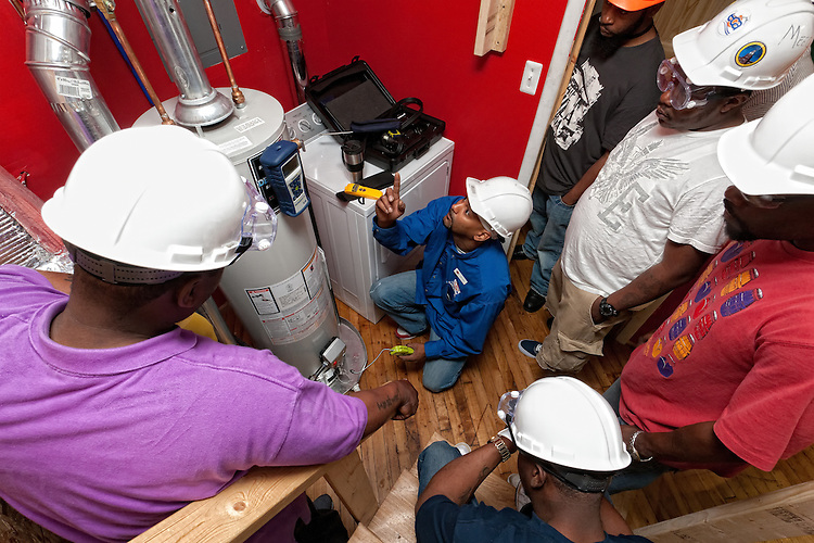 EnergyWorks - Philadelphia Metro Area - All images are from the North Philly Training Center - Instructor showing how to test for proper hot water efficency