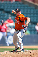Bowie Baysox starting pitcher Jarett Miller (12) makes a pick-off throw to first base against the Richmond Flying Squirrels at The Diamond on May 25, 2015 in Richmond, Virginia.  The Flying Squirrels defeated the Baysox 6-1. (Brian Westerholt/Four Seam Images)