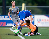 Jordan Angeli (4) of the Boston Breakers can't get a shot on goal as Karina LeBlanc (23) of the Philadelphia Independence secures the ball during a game at John A. Farrell Stadium in West Chester, PA.  Boston defeated Philadelphia, 2-1.