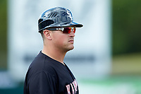 Kannapolis Intimidators manager Justin Jirschele (9) coaches third base during the game against the Hagerstown Suns at Kannapolis Intimidators Stadium on May 6, 2018 in Kannapolis, North Carolina. The Intimidators defeated the Suns 4-3. (Brian Westerholt/Four Seam Images)