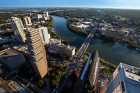 View of Lady Bird Lake and the Congress Ave. Bridge from high atop the Austin Skyline looking south over south Austin.
