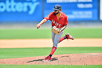 Greenville Drive pitcher Jose Espada (15) delivers a pitch during a game against the Asheville Tourists on July 18, 2021 at McCormick Field in Asheville, NC. (Tony Farlow/Four Seam Images)
