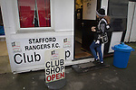Stafford Rangers 2 Chasetown 1, 26/12/2015. Marston Road, Northern Premier League. A girl waiting outside the club shop at Marston Road, home of Stafford Rangers before they played local rivals Chasetown in a Northern Premier League first division south fixture. The club has played at Marston Road since 1896 and achieved prominence in the 1970s and 1980s as one of England's top non-League teams. League leaders Stafford won this match 2-1, despite having a man sent off, watched by a season's best attendance of 978. Photo by Colin McPherson.