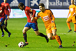 "Club Atletico Osasuna's Oier Sanjurjo ,  Eibar's Cristian Rivera during the match of ""Copa del Rey"" between CA Osasuna and Eibar at El Sadar Stadium in Pamplona. January 03 2017. (ALTERPHOTOS/Rodrigo Jimenez)"
