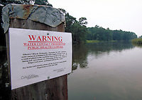 Warning sign along King's Creek, a tributary of the Chesapeake Bay. Creek was closed by Maryland State Health Dept. due to infestation of toxic levels of pfiesteria piscicada. Maryland, Chesapeake Bay.